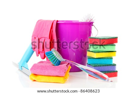 couple of colorful cleaning equipment over white background