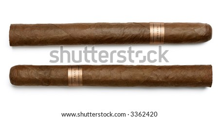 Couple of cuban hand-rolled cigars on white