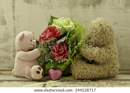 couple of cute  bears holding roses bouquet