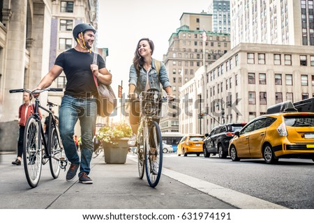 Couple of cyclist in New York - Couple of lovers sightseeing Manhattan on bikes