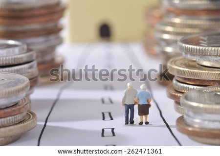 Couple of elderly walking the road surrounded by money Сток-фото ©