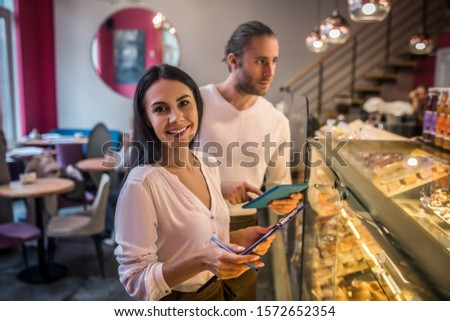 Couple of entrepreneurs. Couple of entrepreneurs working in their French bakery and ordering foods