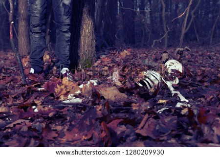 Couple of father and son found human skeleton when walking in winter forest #1280209930