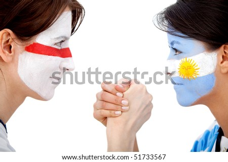 Couple of football fans with their faces painted isolated over white - Argentina versus England