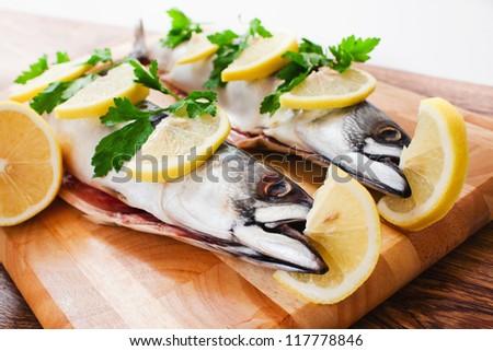couple of fresh mackerel on wood