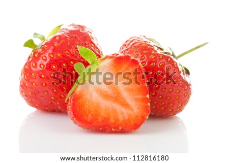 Couple of fresh strawberries in closeup over white background - stock photo