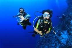 Couple of friends scuba dive together