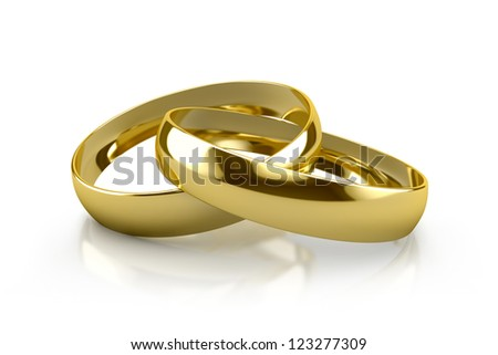 couple of gold wedding rings on white background