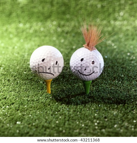 couple of golf ball characters on grass