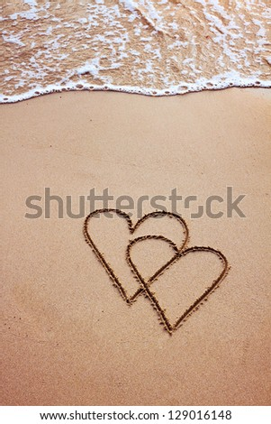 couple of hearts drawn in sand, postcard