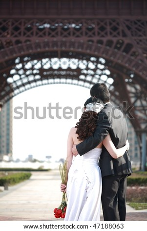 couple of love looking at landscape,back to the lens. - stock photo