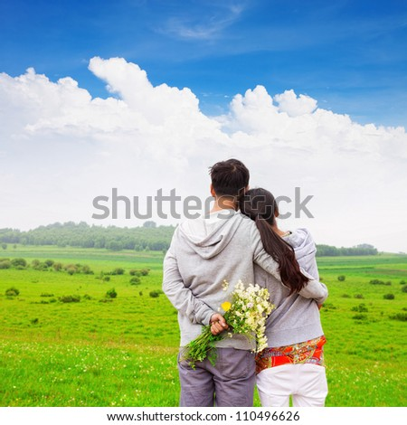 couple of lover holding together with flower