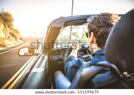 Couple of lovers driving on a convertible car - Newlywed pair on a romantic date