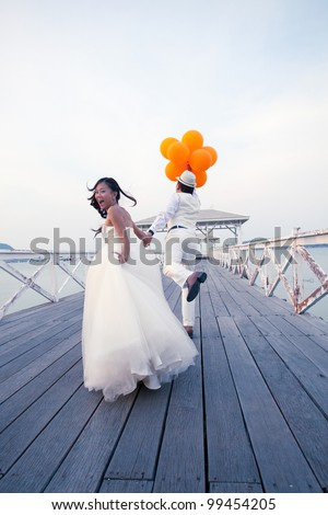 couple of man and women in wedding suit glad emotion on wood bridge