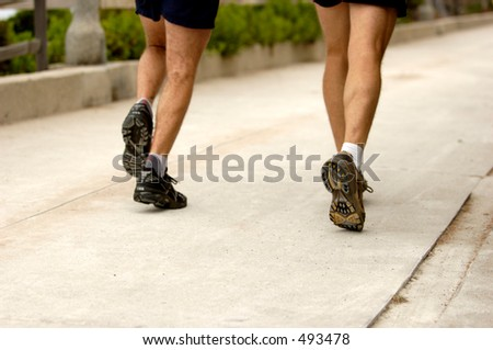 Couple of men running.