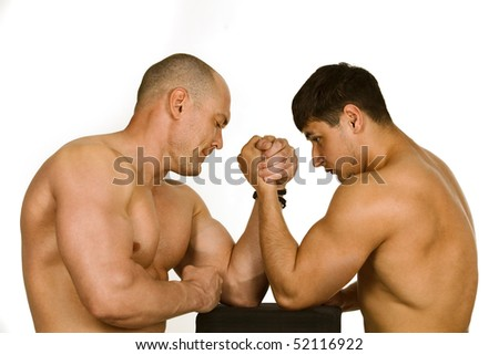 Couple of muscular men measuring forces, isolated on white