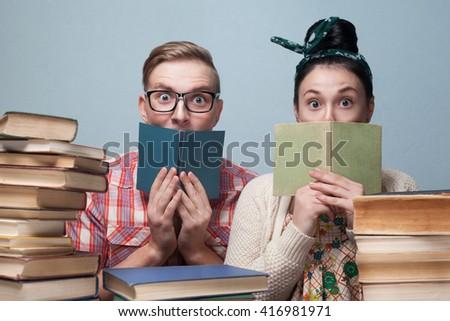 Couple of nerd students preparing to exam