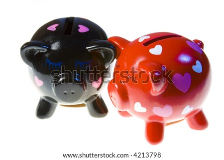 Couple of pigs moneyboxes isolated on a white background.