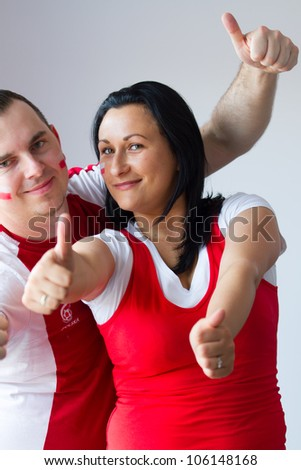 Couple of Polish team fans - stock photo