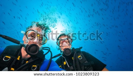 Couple of scuba divers, portrait photography. Underwater sports and activities #1023809323