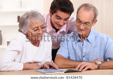 couple of senior citizens having their grandson home