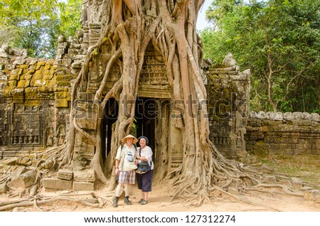 Couple of senior tourists in Ta Som temple, Angkor, Cambodia