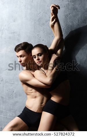 Couple of sporty ballet dancers in art performance #527824372