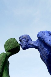 couple of statues giving a kiss in prague