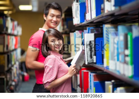 Couple of student spending time in library together
