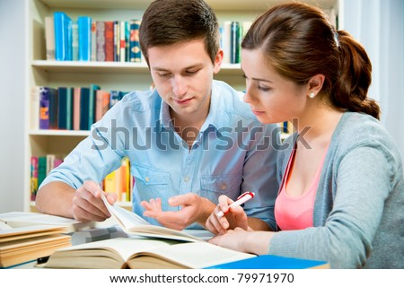 couple of students in a library