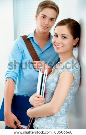 Couple of students  smiling and looking at camera