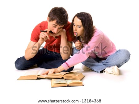 couple of students studying on the floor