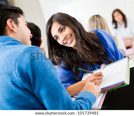 Couple of students talking in class and smiling
