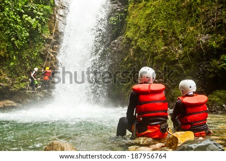 Couple Of Tourist Admiring The Nature Beautiful Of A Waterfall Canyoning Trip