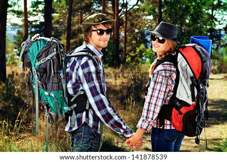 Couple of tourists follow the trekking trail.