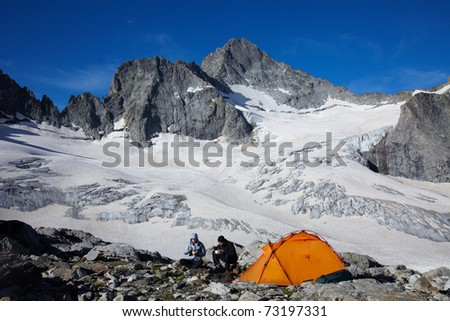 Couple of tourists having a breakfast in high mountains
