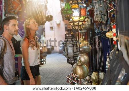 Couple of tourists in Moroccan souk, Marrakech medina