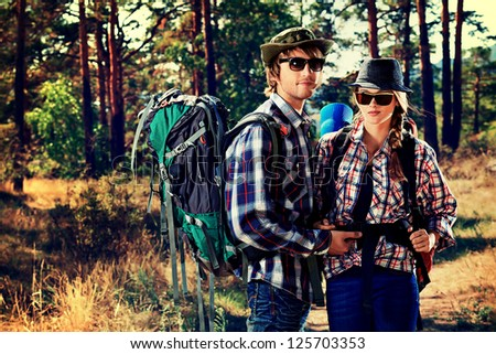 Couple of tourists on a trekking trail.