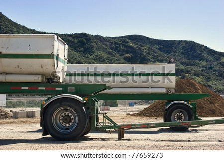 Couple of trailers a wait for usage in truck lot. - stock photo