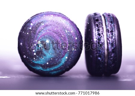 Couple of Ultra Violet macaroos with space pattern, macro. Color of the year 2018.