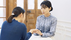 Couple of woman talking in room. Beauty adviser. Fortune teller.