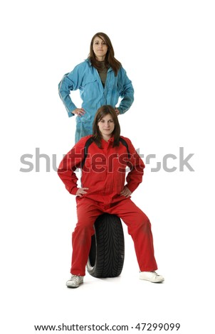couple of young female workers standing, sitting on a tire on white background