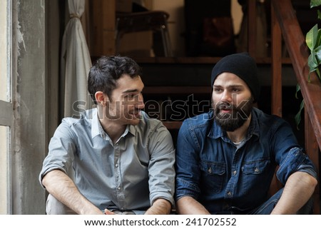 Couple of young men talking on the stairs of an office Stock photo ©