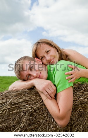 couple of young people lying on the hay