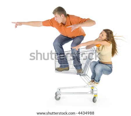 Couple of young people riding by trolley. Having fun. Isolated on white in studio. Showing something. Side view