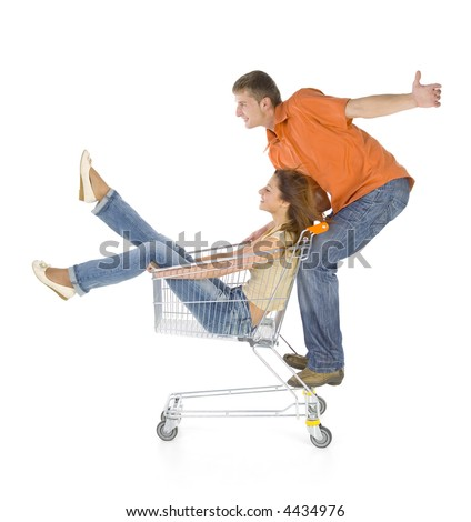 Couple of young people riding by trolley. Having fun. Isolated on white in studio. Side view