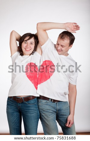 couple of young people trying to make a picture of the halves of the heart