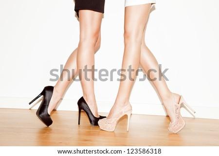 couple of young women in high heel shoes indoor shot