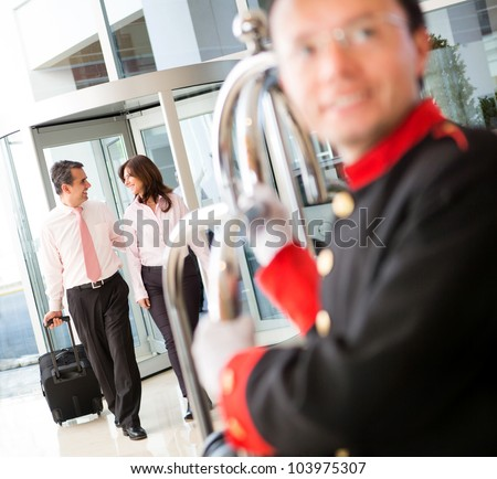 Couple on a business trip arriving to the hotel