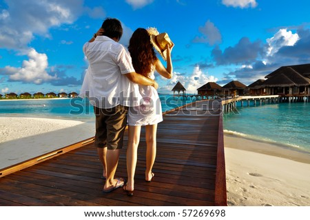 Couple on a pathway of luxury resort, Maldives